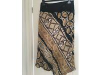 Ladies skirt geometric design, Rosie's, in black, beige and cream with dip hem size 14