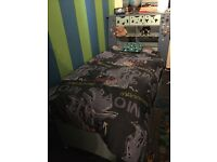 Boys blue bed with storage