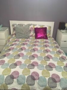 Duvet, pillow shams, cushions and curtains.    Purple theme