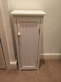 Small white storage cabinet