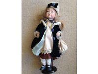 Period dressed female porcelain doll