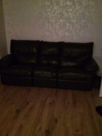 Large three seater leather sofa in good condition