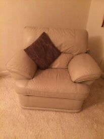 A pair of cream lounge leather reclining chairs