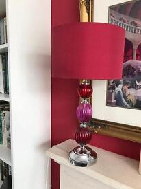 Red lamp and shade. Very glamorous.
