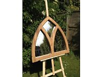A solid oak triple arched mirror.