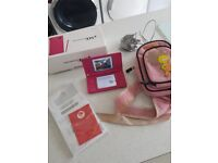 Pink Nintendo DSI computer console boxed with instructions & bag
