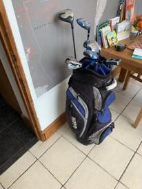 Set of graphite golf clubs and carry bag