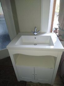 Delivery avail locally. Very heavy bathroom sink/vanity unit white
