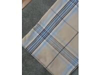 Blue and beige eyelet curtains with matching duvet covers and pillowcases