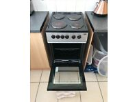 Beko freestanding electric cooker with solid plate hob 50cm black and silver