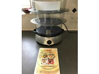 Tefal Steam Cuisine for steaming vegetables and rice. 1000cl. Includes instructions.