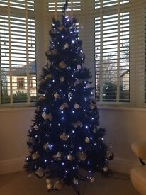 Black 5ft artificial Christmas tree with bright white led lights, identical baubals. Exc condition .