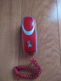 Small, cute, simple landline phone.