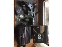 Panasonic Lumix DMC-G3 camera body , 2 lenses , case strap etc .