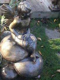 Beautiful large bronze fairy on toadstool