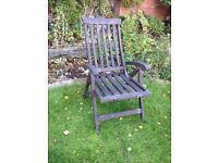 Wooden garden lounger in need of roc