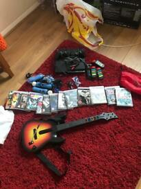 PS3 with games 2 controllers including motion controllers, and guitar for games