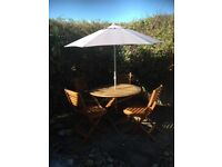 Garden table chairs and canopy