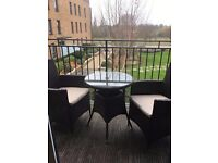 Ratan style garden set - Table and two chairs