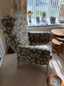 Upholstered high back chair.