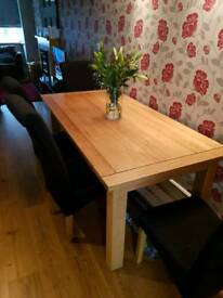 Solid oak table 6 x 3 4 black chairs