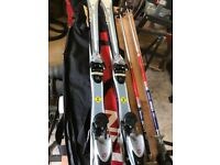 skis with poles and carry bag.