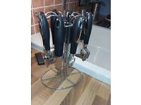 kitchen utensil set with stand.