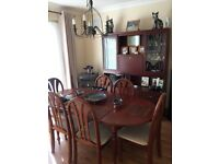 Dining room table and 6 chairs plus display cabinet