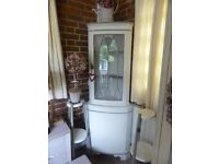 Stunning corner cupboard with glass front. Ideal for storage for kitchen, bathroom or hallway