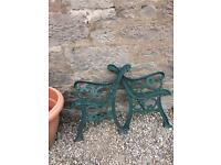 Two cast iron bench ends arms