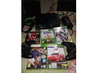 XBOX 360 with 2 controllers, headset and 5 games