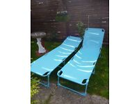 pair of garden loungers aqua blue