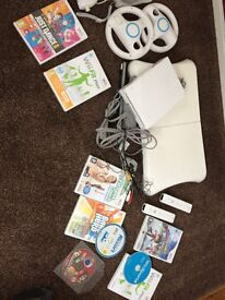 Nintendo Wii Plus Wii Fit and Games 2 Controllers 2 Steering Wheels 2 Nunchunks