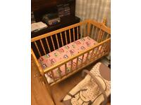 Baby's rocking crib with two mattresses light pine like new