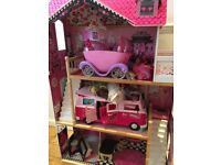 Large dolls house with selection of toys