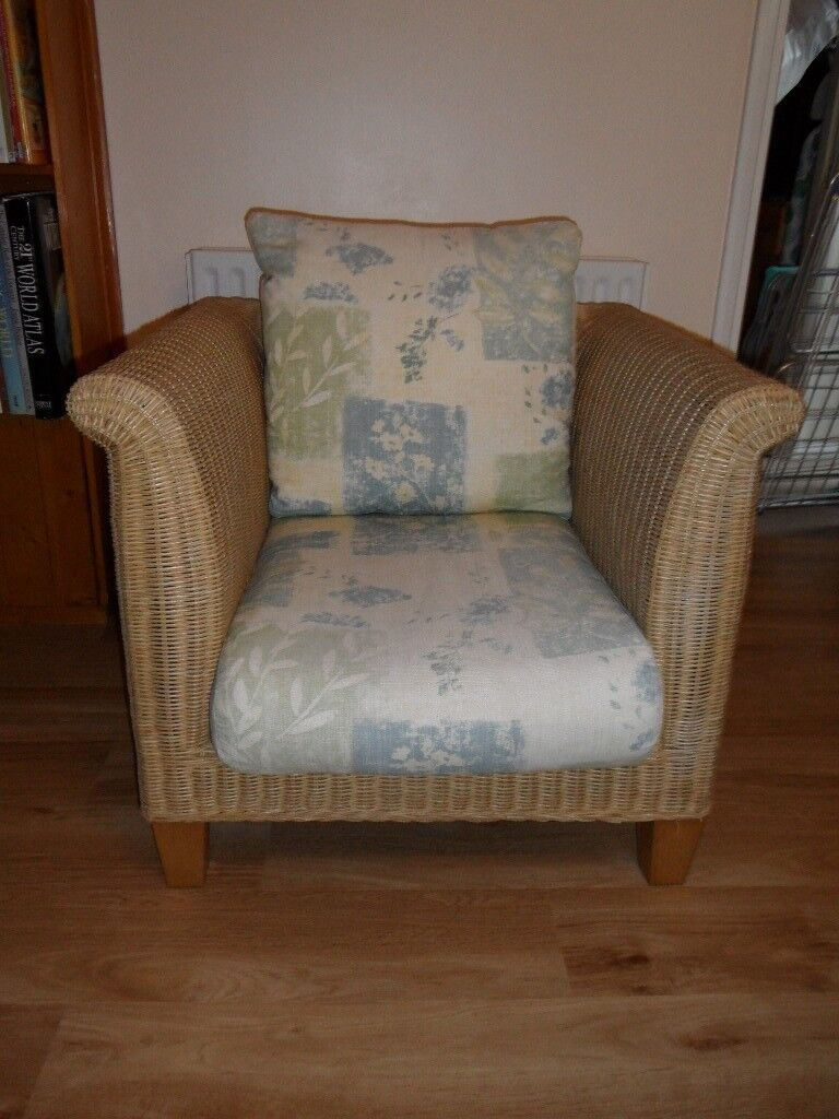 RATTAN CHAIR IN GOOD CONDITION WITH NEW CUSHION COVERS £25