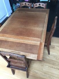 Antique oak table with drop leaf. Seats 6.