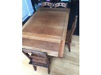 Antique oak double leaf table, carved legs. Pew oak chairs also ava