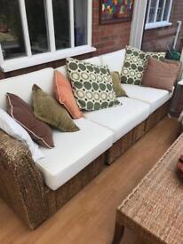 Rattan sofa, single sofa chair, pouffe and table set.