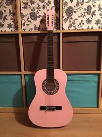 Pink junior guitar