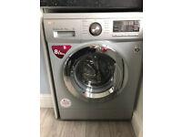 9-month old washing machine ** Freestanding Washer Dryer ** LG * silver