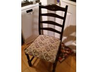 Dark oak dining table and four chairs.