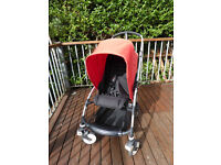 Red Bugaboo Bee Single Seat pushchair with baby cocoon