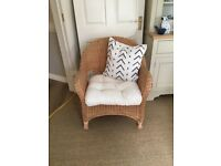 three comfortable wicker armchairs including cushions