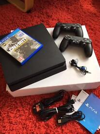 PlayStation 4 with extra controller and games