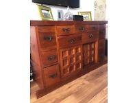 Solid wood sideboard rose wood with lots of storage space. 55cm x 150 cm x86 high