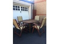 Extendable garden table and matching chairs