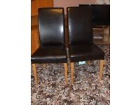 Pair Of Scroll Back Brown Faux Leather Dining Chairs can be sold separately