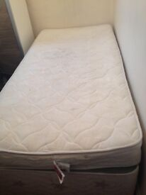 Good size single bed with extra mattress