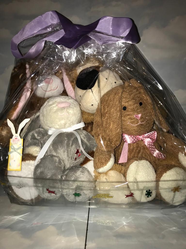 Cuddly Rabbits And A Bear.